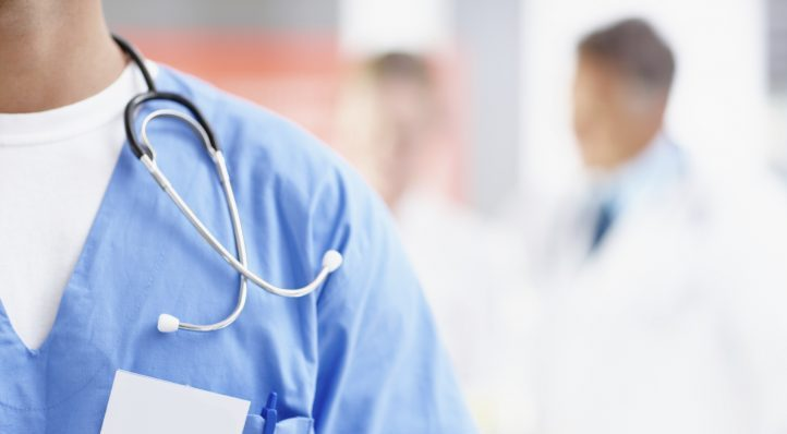 Cropped image of a male surgeon wearing a nametag alongside copyspace